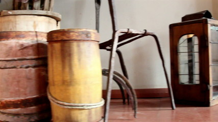 Three wooden barrels and an old lamp