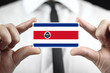 Businessman holding business card with Costa Rica Flag