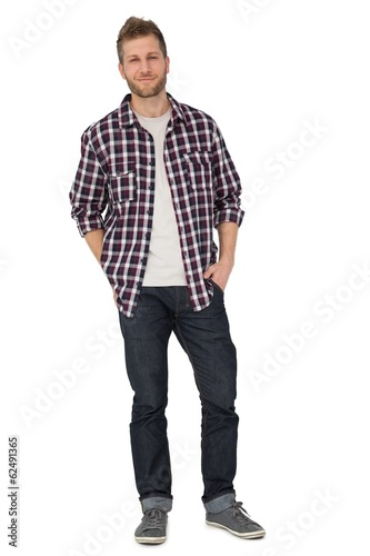 Portrait of a young man with hands in pockets