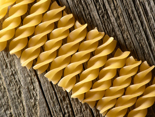 pasta spiral on the wooden background