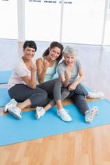Full length portrait of happy women in yoga class
