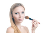 Beauty photo of girl with makeup brush.