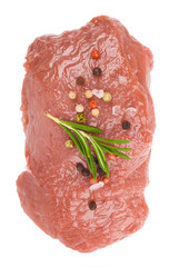 Raw ribeye steak garnished with a sprig of rosemary.