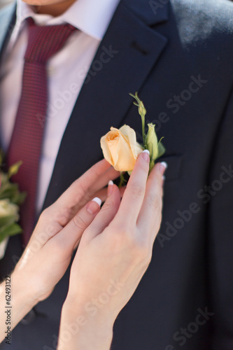 Hands of bride outdoors
