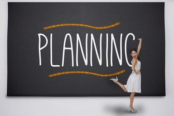 Pretty asian woman against the word planning