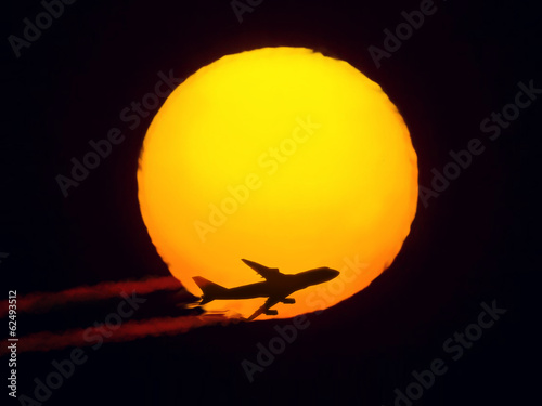 aircraft flying through the sun
