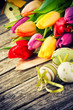 Easter setting with multicolor tulips