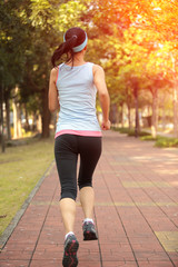 healthy sports woman running at city street