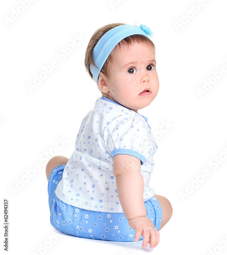 Cute baby girl sitting isolated on white