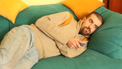Man Watching TV on Sofa