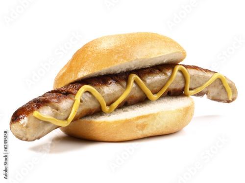 Leinwanddruck Bild Bratwurst im Brötchen