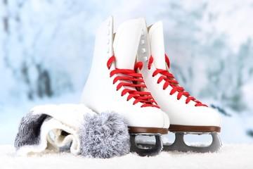 Figure skates on winter background