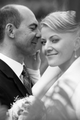 closeup shot of happy middle aged bride and groom