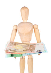 Wooden small mannequin with money isolated on white