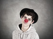 closeup portrait of young teenage girl with clown costume