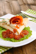 Pancake with salmon, red caviar and mayo, green onion,