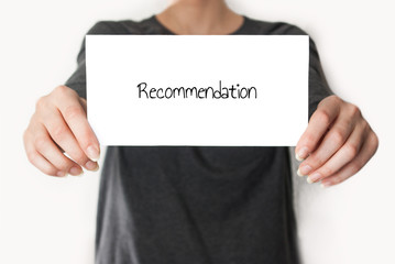Recommendation letter held in hand