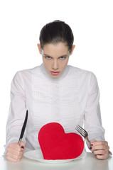 Femme fatale eats heart knife and fork