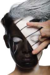 woman with musical face art and rock gesture