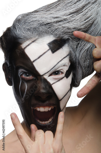 Vertical portrait with makeup and rock gesture