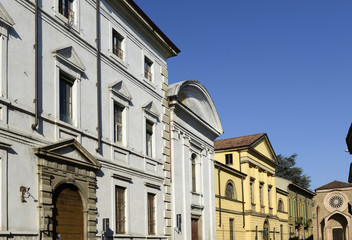 neoclassic buildings in old street, Lodi, Italy