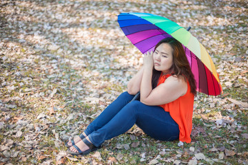 Young fat woman sitting