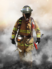 A firefighter pierces through a wall of smoke