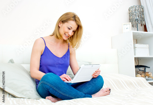 woman with laptop in her bed