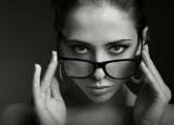 Sexy woman in modern glasses looking. Black and white portrait