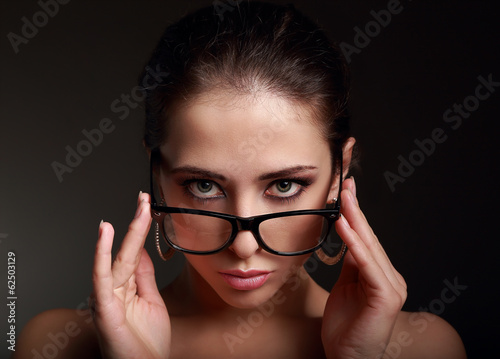 Sexy makeup woman in fashion glasses looking hot