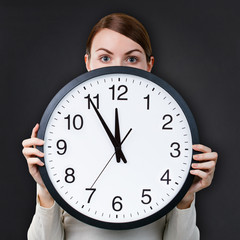 Time management for woman - concept. Woman with an office clock