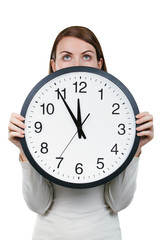 Woman holding an office clock isolated on a white background