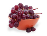 Branch of purple grapes in orange Bowl