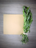 Rosemary Bound on a Wooden Board Background. Lots of copy space.