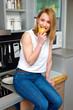 attractive woman in kitchen eating apple