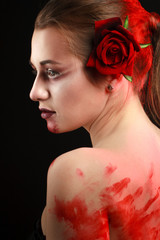 portrait of beautiful gothic girl with rose and blood. blood
