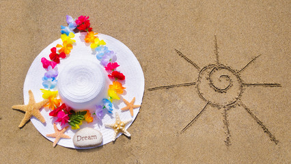 woman's white hat on the sandy beach