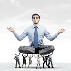 Meditating businessman
