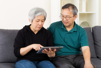 Asia old couple using tablet