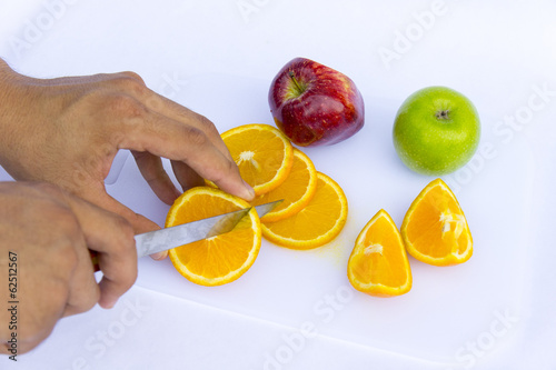 cutting the orange fruit
