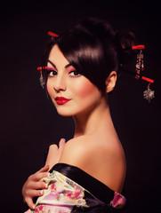 Beautiful woman in Asian costume on black
