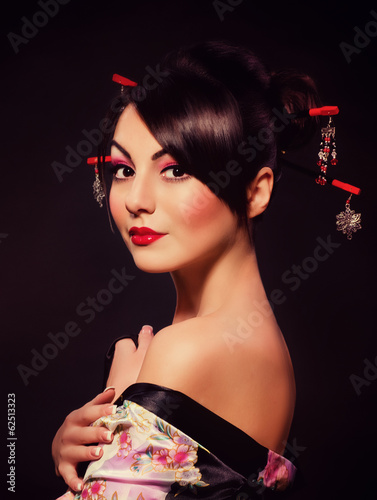 Beautiful woman in Asian costume on black