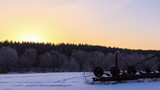 The sun rises over a field of snow. Time Lapse