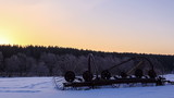 Tractor rake the snow at dawn. Time Lapse