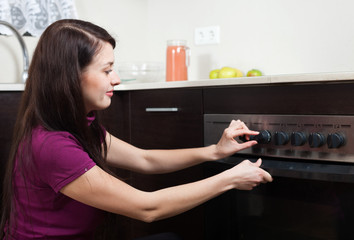 Woman cooking something in the oven