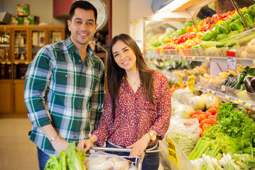 Cute couple in a grocery store