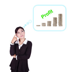 Business woman thinking about profit and coin graph