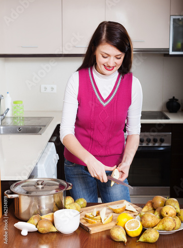 Woman cooking pear jam