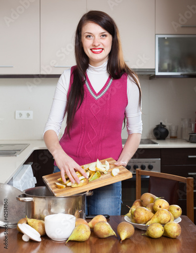 Brunette girl cooking pear jam