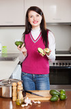 girl with avocado in  kitchen